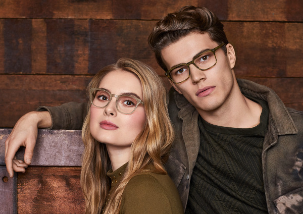 A man and a woman modelling some glasses frames