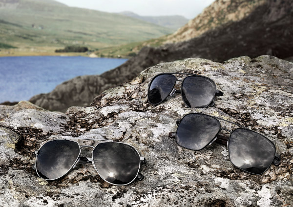 3 Pairs of Eyespace Land Rover Sunglasses on a rock