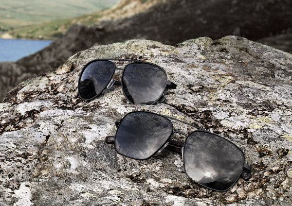 2 Pairs of Eyespace Land Rover Sunglasses on a rock