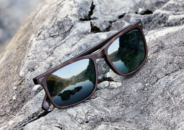 Pair of Eyespace Land Rover Sunglasses on a rock