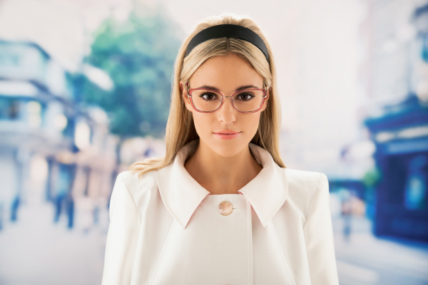 Photo of a lady wearing Paul Costello glasses