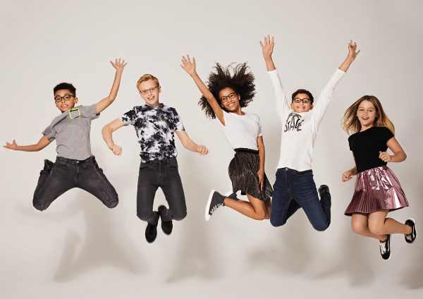Photo of children jumping in the air
