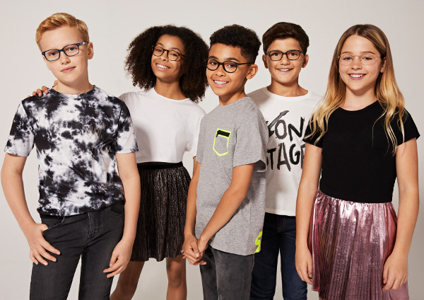 Photo of children looking happy wearing glasses