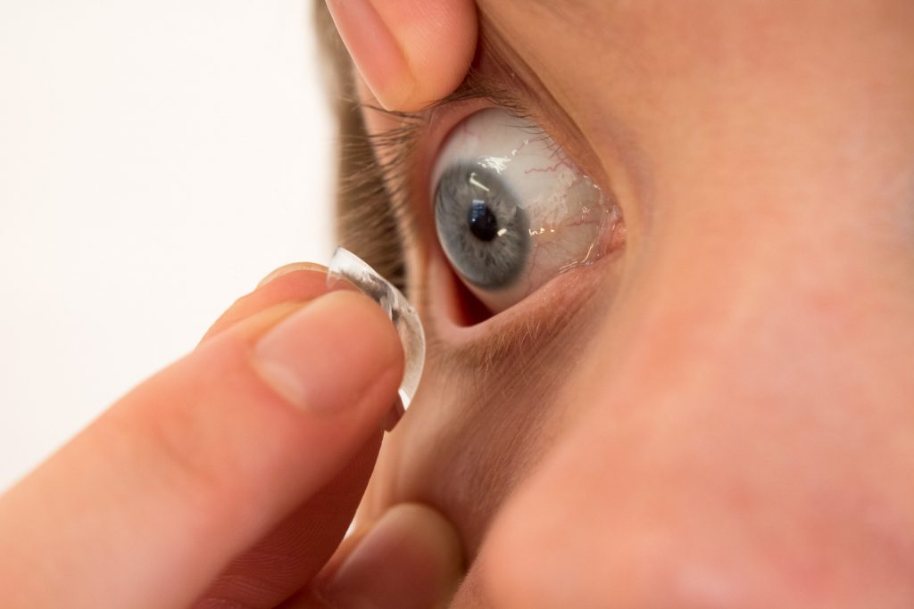 A close up photo of an eye with a contact lens