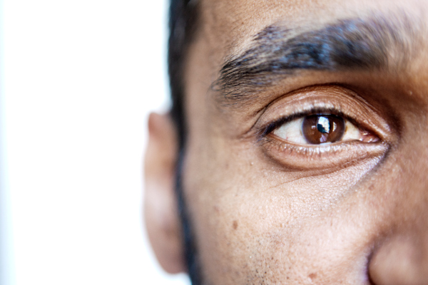 A close up photo of a mans brown eye