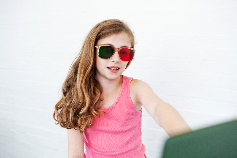 A young girl wearing glasses with red and green lenses